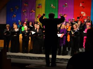 Roger Girard  leads the Show Chorus
